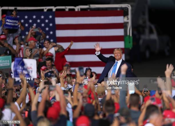 President Donald Trump waves as he leaves after speaking during his 'The Great American Comeback Rally' at Cecil Airport on September 24 2020 in...
