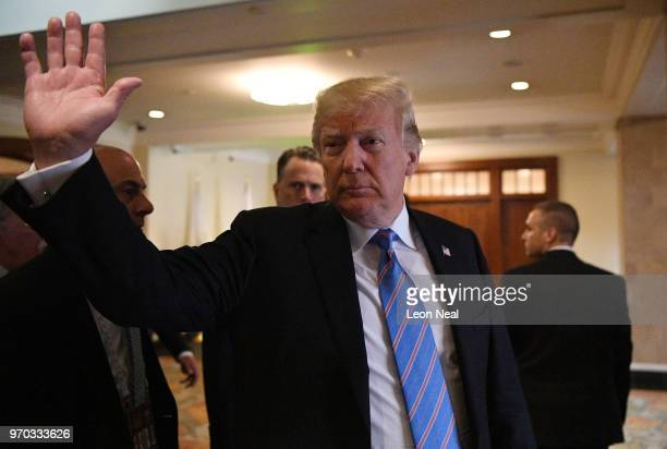 President Donald Trump waves as he leaves the main building at the G7 Summit on June 9 2018 in Quebec City Canada Canada are hosting the leaders of...