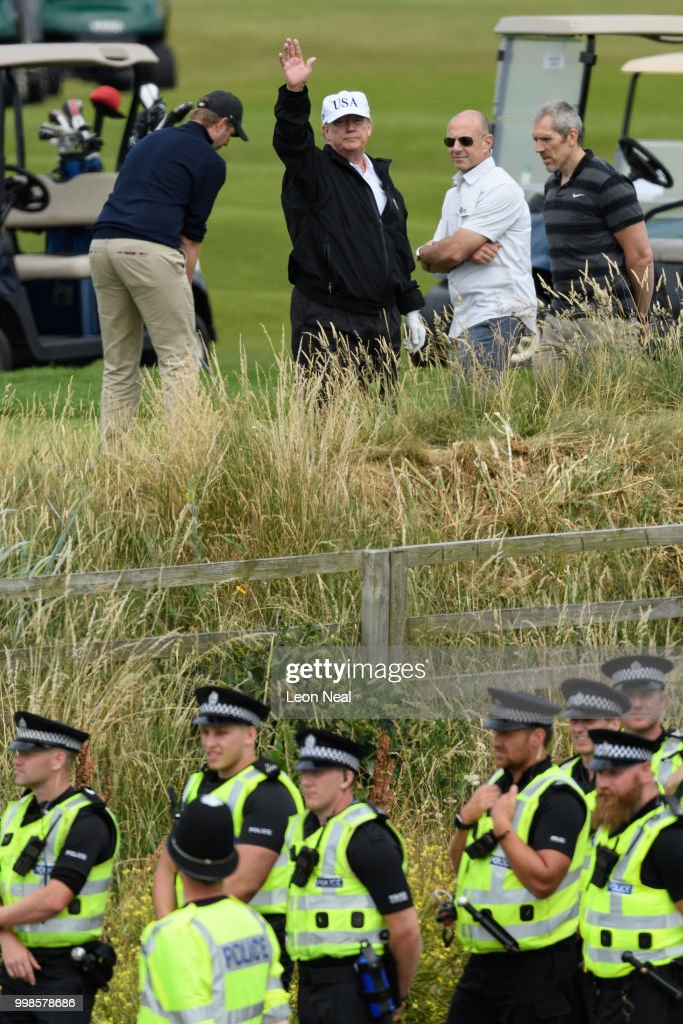 U.S. President Donald Trump (C) waves as he plays golf at Trump Turnberry Luxury Collection Resort during the President's first official visit to the United Kingdom on July 14, 2018 in Turnberry, Scotland. The President of the United States and First Lady, Melania Trump on their first official visit to the UK after yesterday's meetings with the Prime Minister and the Queen is in Scotland for private weekend stay at his Turnberry.