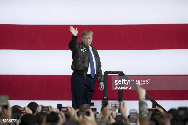 US President Donald Trump waves as he walks off stage after addressing US military personnel at Yokota Air Base in Fussa Tokyo Metropolis Japan on...