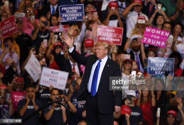 S President Donald Trump waves as he walks onstage for a campaign rally at the Las Vegas Convention Center on September 20 2018 in Las Vegas Nevada...