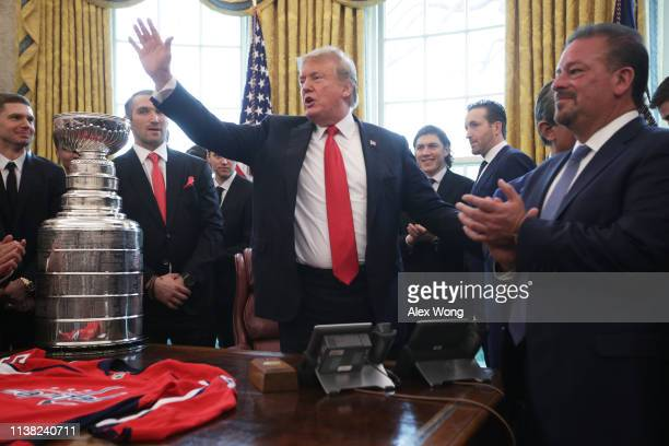 S President Donald Trump waves as left wing and MVP Alexander Ovechkin of the Washington Capitals and other team members look on during an Oval...