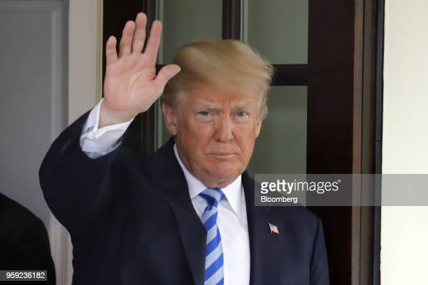 US President Donald Trump waves as Shavkat Mirziyoev Uzbekistan's president not pictured leaves after a meeting at the White House in Washington DC...
