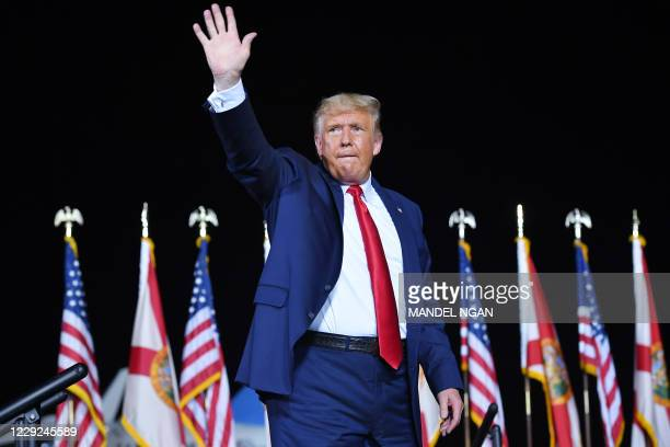 President Donald Trump waves at the end of a campaign rally at Pensacola International Airport in Pensacola, Florida on October 23, 2020.