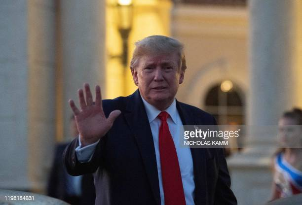 President Donald Trump waves at the Trump International Golf Club as he arrives for a Super Bowl viewing party in West Palm Beach on February 2, 2020.