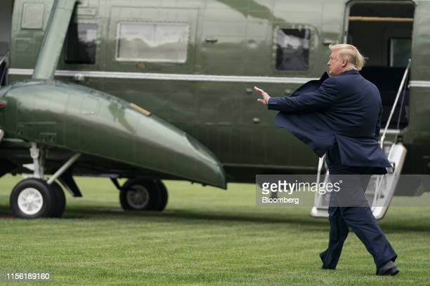 US President Donald Trump waves before boarding Marine One on the South Lawn of the White House in Washington DC US on Wednesday July 17 2019...