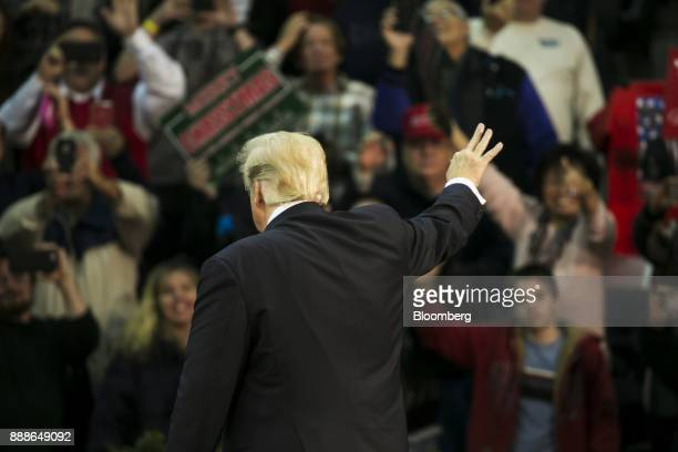 US President Donald Trump waves during a rally in Pensacola Florida US on Friday Dec 8 2017 Trumpgave his most fullthroated endorsement yet of...