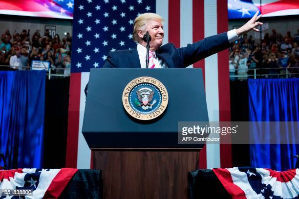 US President Donald Trump waves during rally a for Alabama state Republican Senator Luther Strange at the Von Braun Civic Center September 22 2017 in...