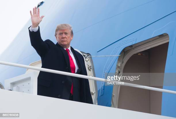 US President Donald Trump waves from Air Force One prior to departure from Andrews Air Force Base in Maryland December 4 as Trump travels to Salt...