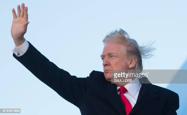 President Donald Trump waves from Air Force One prior to departure from Joint Base Andrews in Maryland February 2 as he travels to Mar a Lago in West...