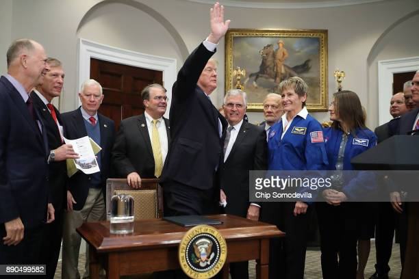 S President Donald Trump waves goodby after signing 'Space Policy Directive 1' during a ceremony with Vice President Mike Pence Sen Bill Nelson and...