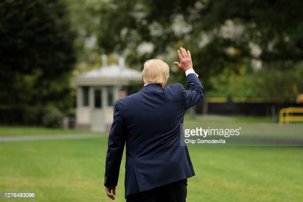 President Donald Trump waves goodbye to employees as he deaprts the White House September 24, 2020 in Washington, DC. Trump is traveling to North...