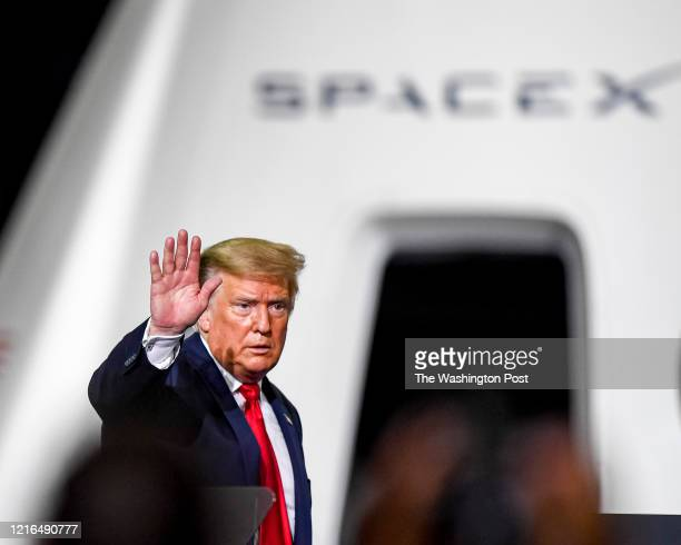 President Donald Trump waves goodbye to the crowd after attending a post launch gathering after NASA commercial crew astronauts Doug Hurley and Bob...