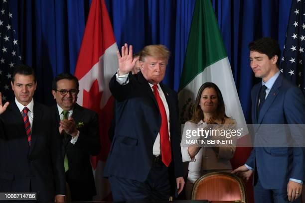 US President Donald Trump waves next to Mexican President Enrique Pena Nieto Mexican Economy Minister Ildefonso Guajardo Canadas Foreign Affairs...