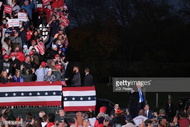 President Donald Trump waves supporters during a campaign event on October 24, 2020 in Circleville, Ohio. President Trump continues to campaign...