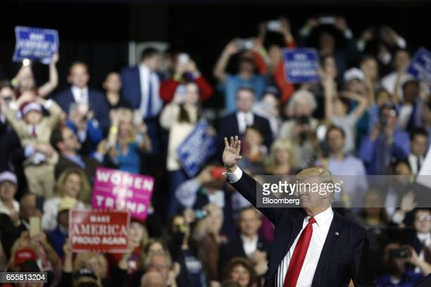 US President Donald Trump waves to attendees as he arrives for a rally at the Kentucky Exposition Center in Louisville Kentucky US on Monday March 20...