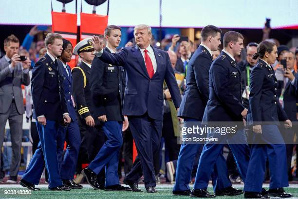 S President Donald Trump waves to fans from the field prior to the College Football Playoff National Championship Game between the Alabama Crimson...