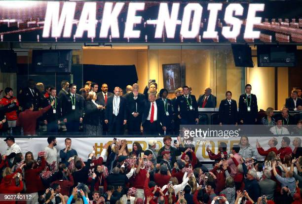 S President Donald Trump waves to fans prior to the CFP National Championship presented by ATT between the Georgia Bulldogs and the Alabama Crimson...