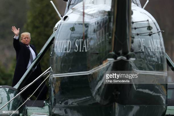 US President Donald Trump waves to journalists as he boards Marine One on departure from Walter Reed National Military Medical Center following his...