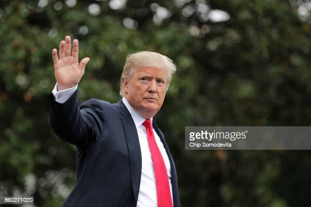 S President Donald Trump waves to journalists as he leaves the White House October 11 2017 in Washington DC According to the White House Trump is...