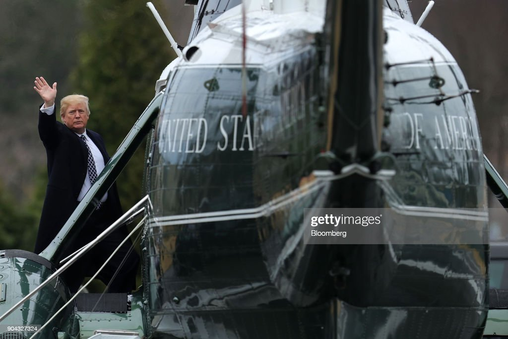 U.S. President Donald Trump waves to members of the media before boarding Marine One following his first medical exam at Walter Reed National Military Medical Center in Besthesda, Maryland, U.S., on Friday, Jan. 12, 2018. Trump is predicting that his first physical since taking office will show he is in good health as the White House moves to stamp out fresh questions about whether the 71-year-old is mentally fit for office. Photographer: Chip Somodevilla/Pool via Bloomberg
