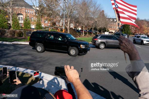 President Donald Trump waves to supporters as he departs from the Trump National Golf Club on November 14, 2020 in Sterling, Virginia. President...