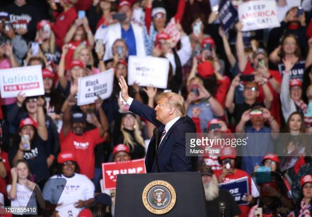President Donald Trump waves to supporters at a campaign rally at Las Vegas Convention Center on February 21 2020 in Las Vegas Nevada The upcoming...