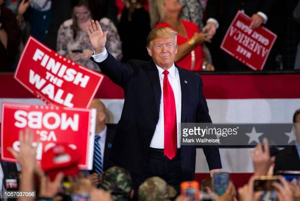 S President Donald Trump waves to supporters at a campaign rally at the Pensacola International Airport on November 3 2018 in Pensacola Florida...