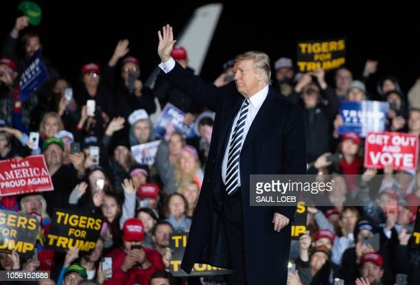 US President Donald Trump waves to supporters during a campaign rally at Columbia Regional Airport in Columbia Missouri November 1 2018