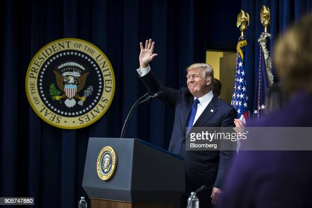 US President Donald Trump waves to the audience after speaking during a 'Conversations with the Women of America' event at the Eisenhower Executive...