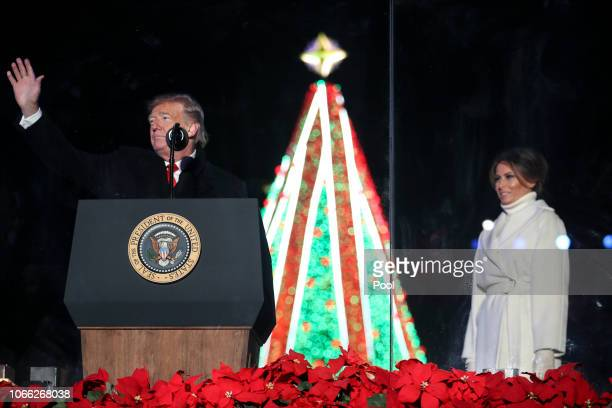 President Donald Trump waves to the audience during the National Christmas Tree lighting ceremony held by the National Park Service at the Ellipse...