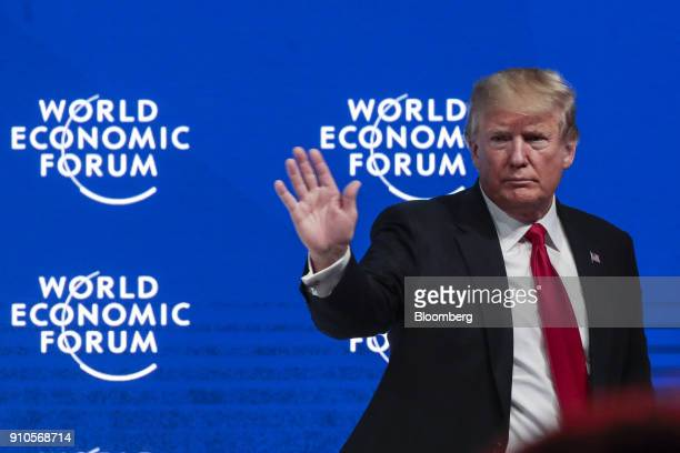 US President Donald Trump waves to the audience following a special address on the closing day of the World Economic Forum in Davos Switzerland on...