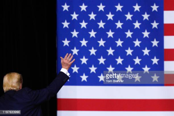 President Donald Trump waves to the audience while departing from the podium following his remarks at a campaign rally inside of the Knapp Center...