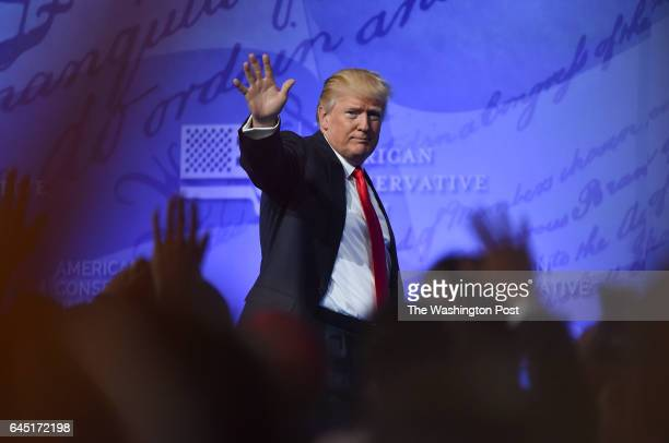 President Donald Trump waves to the crowd after addressing them during CPAC at the Gaylord National Resort Convention Center on February 24 2017 in...
