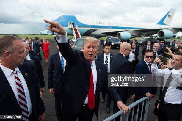 President Donald Trump waves to the crowd after disembarking from Air Force One upon arrival at Tampa International Airport in Tampa Florida July 31...