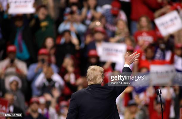 President Donald Trump waves to the crowd after speaking to a crowd of supporters at a Make America Great Again rally on April 27 2019 in Green Bay...