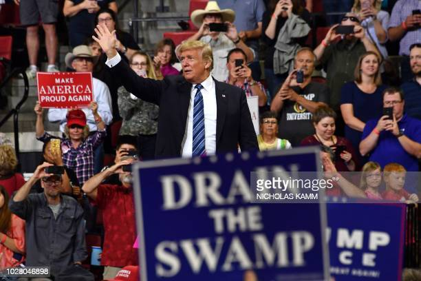 US President Donald Trump waves to the crowd during a Make America Great Again rally in Billings Montana on September 6 2018