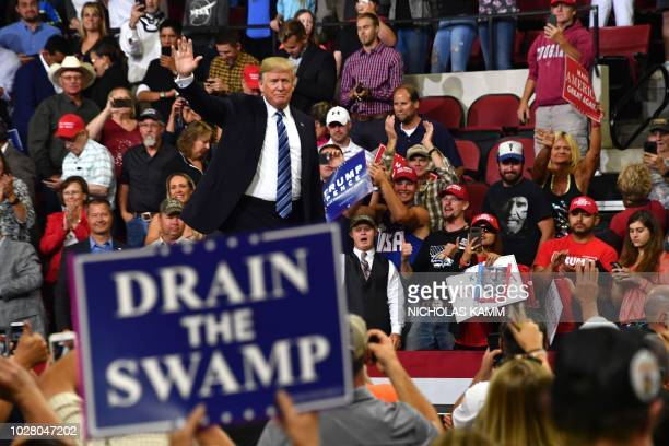 President Donald Trump waves to the crowd during a Make America Great Again rally in Billings Montana on September 6 2018