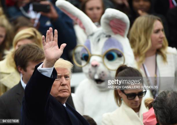US President Donald Trump waves to the crowd during Easter celebrations at the White House in Washington DC on April 2 2018 / AFP PHOTO / ANDREW...