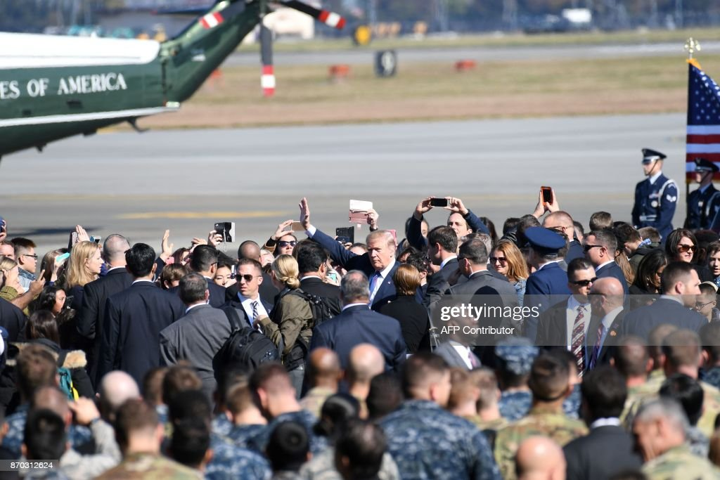 US President Donald Trump waves upon arriving at US Yokota Air Base in Tokyo on November 5, 2017. Trump touched down in Japan, kicking off the first leg of a high-stakes Asia tour set to be dominated by soaring tensions with nuclear-armed North Korea. / AFP PHOTO / Toshifumi KITAMURA / The erroneous mention[s] appearing in the metadata of this photo by Toshifumi KITAMURA has been modified in AFP systems in the following manner: [November 5] instead of [November 4]. Please immediately remove the erroneous mention[s] from all your online services and delete it (them) from your servers. If you have been authorized by AFP to distribute it (them) to third parties, please ensure that the same actions are carried out by them. Failure to promptly comply with these instructions will entail liability on your part for any continued or post notification usage. Therefore we thank you very much for all your attention and prompt action. We are sorry for the inconvenience this notification may cause and remain at your disposal for any further information you may require.