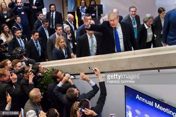 President Donald Trump waves upon his arrival at the Economic Forum annual meeting on January 25 2018 in Davos eastern Switzerland The world's...
