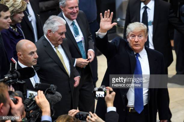 US President Donald Trump waves upon his arrival with Secretary of State Rex Tillerson for the World Economic Forum annual meeting in Davos eastern...