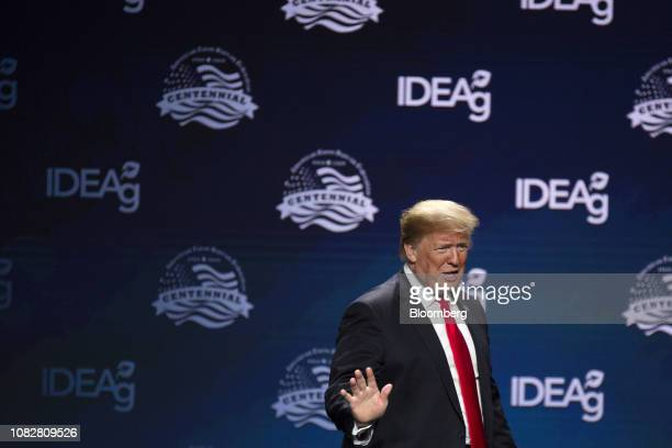 US President Donald Trump waves while arriving on stage during the 100th American Farm Bureau Federation Convention in New Orleans Louisiana US on...