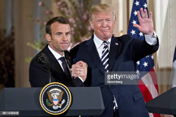 S President Donald Trump waves while embracing Emmanuel Macron France's president left at a news conference in the East Room of the White House...