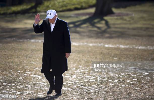 S President Donald Trump waves while returning from a weekend trip with Republican leadership to Camp David on the South Lawn of the White House in...