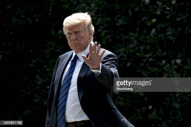 US President Donald Trump walks on the South Lawn of the White House before boarding Marine One in Washington DC US on Friday July 20 2018 Trump...