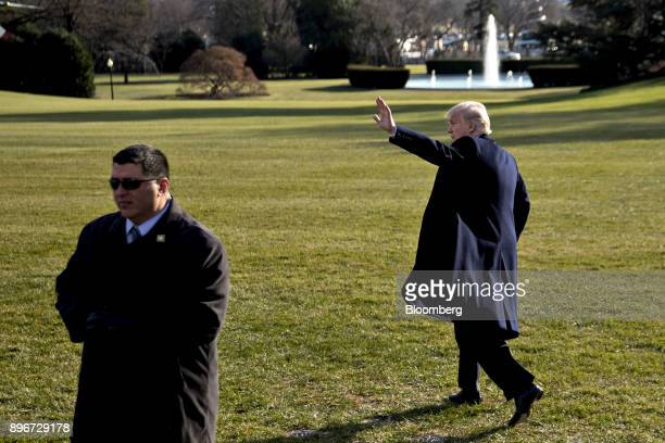 US President Donald Trump waves while walking to board Marine One on the South Lawn of the White House in Washington DC US on Thursday Dec 21 2017...