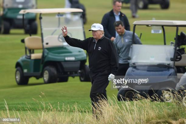 S President Donald Trump waves whilst playing a round of golf at Trump Turnberry Luxury Collection Resort during the US President's first official...