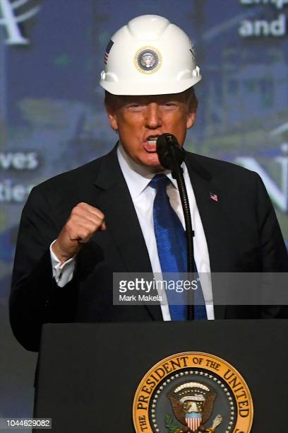 S President Donald Trump wears a hard hat as he addresses the National Electrical Contractors Convention on October 2 2018 in Philadelphia...