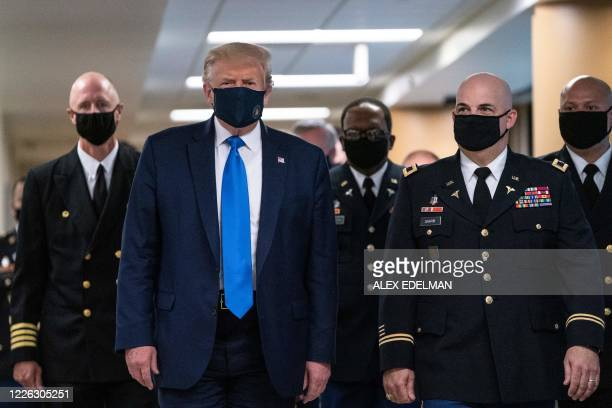 President Donald Trump wears a mask as he visits Walter Reed National Military Medical Center in Bethesda Maryland' on July 11 2020
